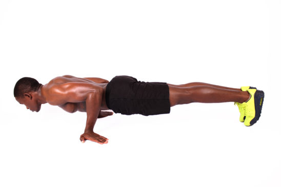 Fit athletic man doing semi planche push ups