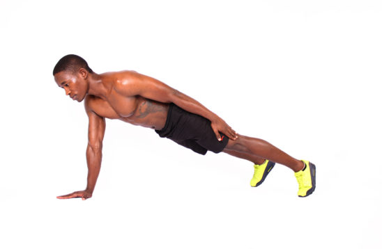 Fit man doing one arm push ups