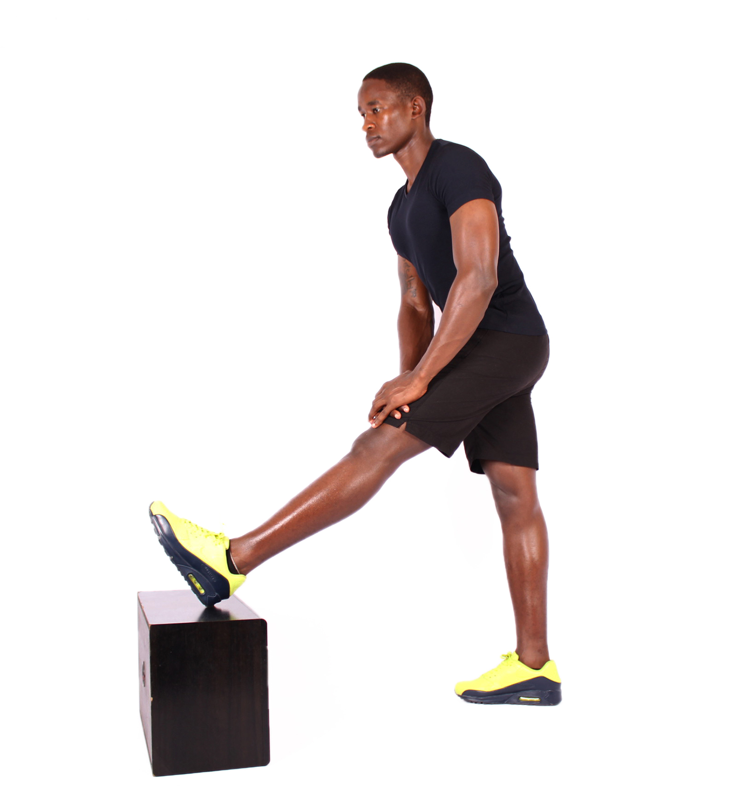 Fit man stretching leg muscles on step up box