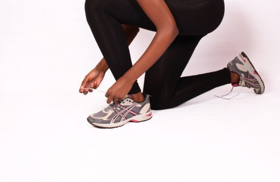Fit Woman Tying Shoelaces Ready to Exercise