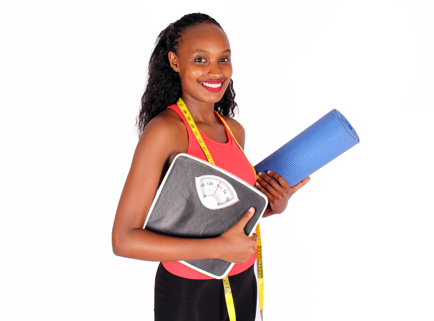 Fit woman with tape measure yoga mat and weigh scale