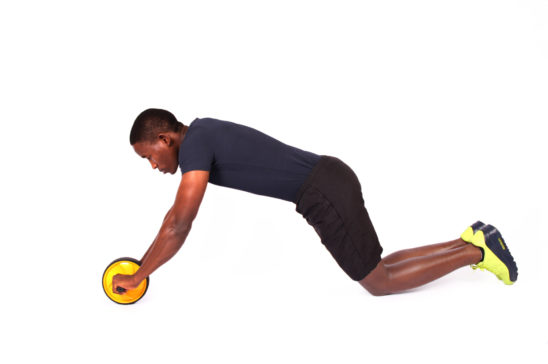 Fitness man doing ab wheel roller ab exercise