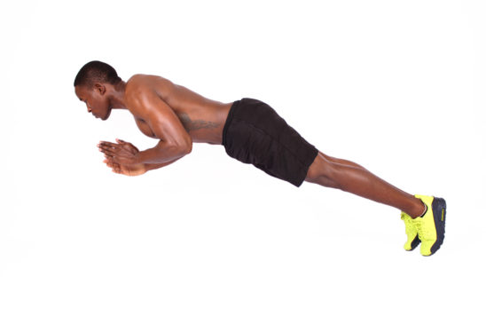 Fitness man doing clap push ups