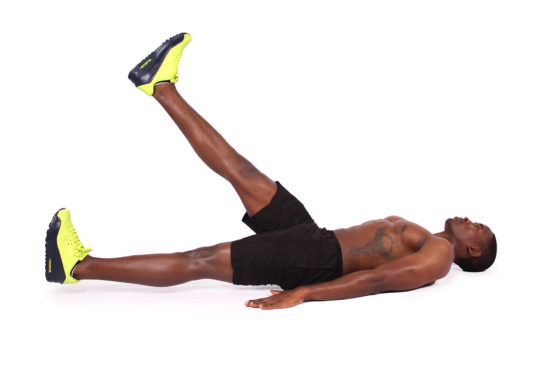 Fitness man doing flutter kicks ab exercise