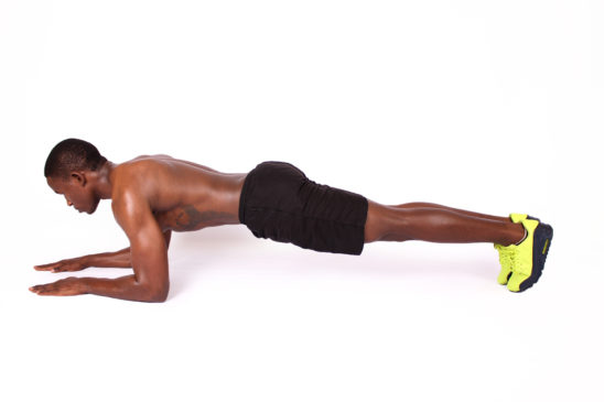 Fitness man doing plank exercise workout