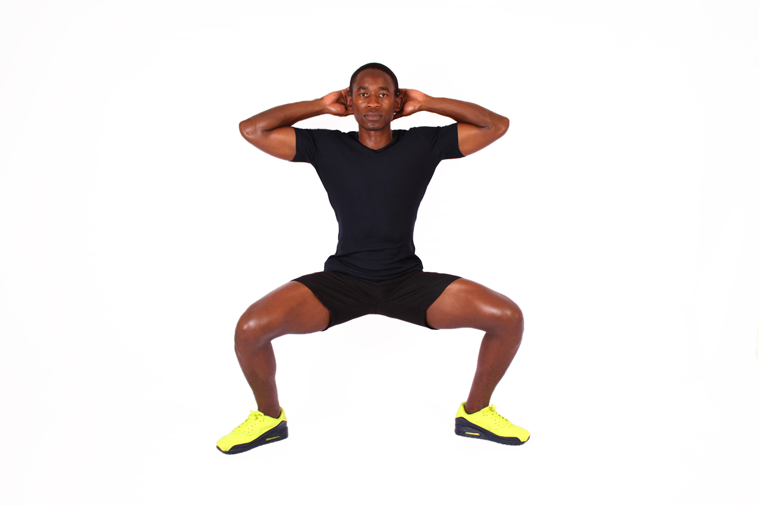 Fitness man doing sumo squat exercise