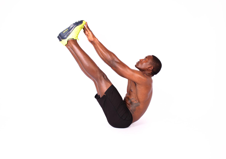 Fitness man doing v ups ab exercise