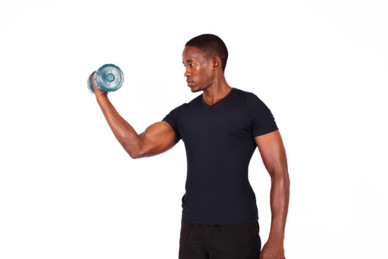 Fitness man exercising with a dumbbell