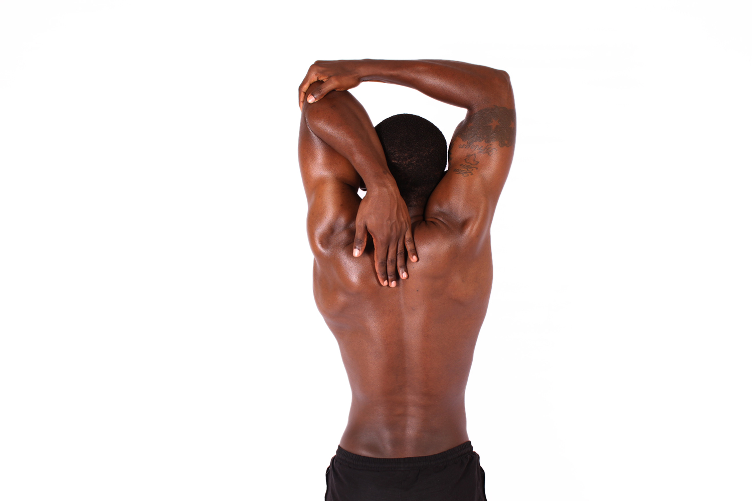 Fitness man stretching shoulder muscles