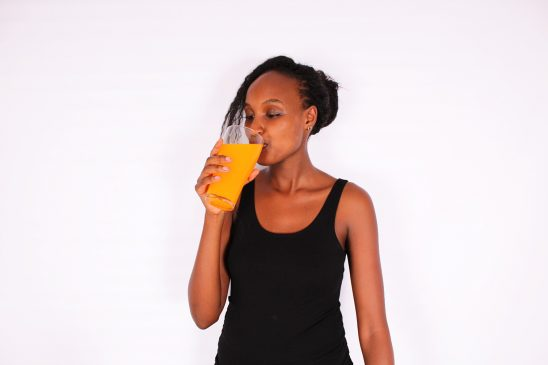 Fitness woman drinking fresh juice