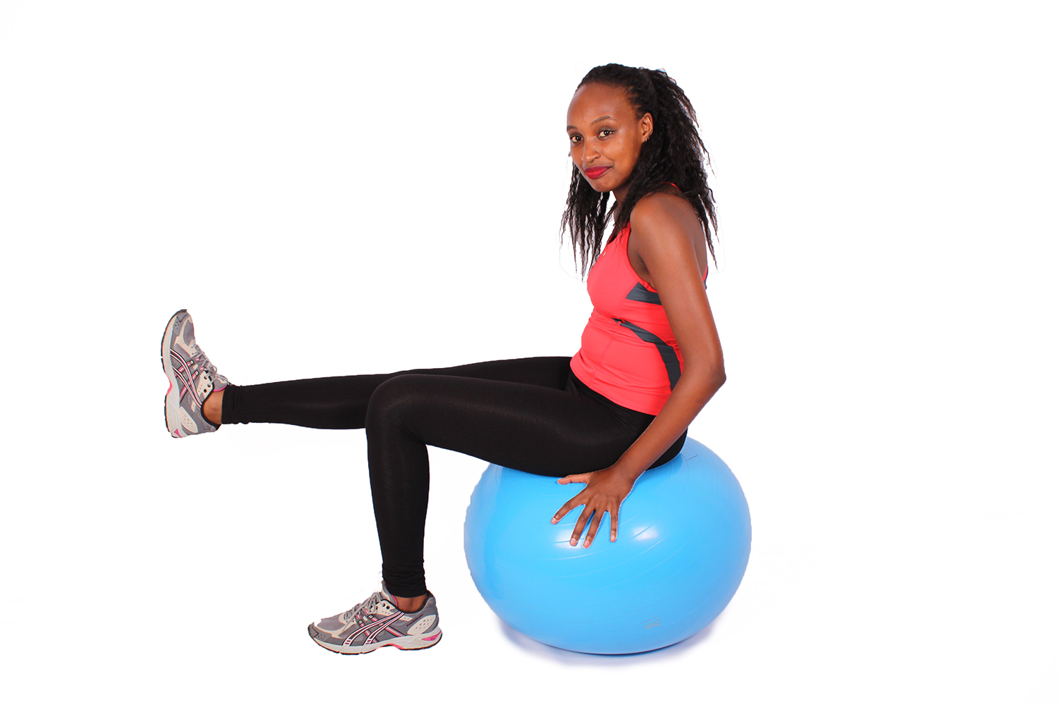 Fitness woman exercising on swiss ball