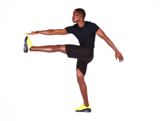 Flexible man doing high kicks exercise