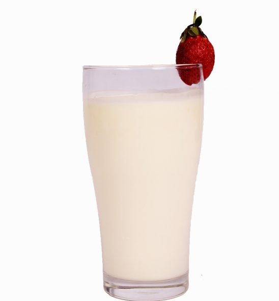 Glass of yogurt with a strawberry