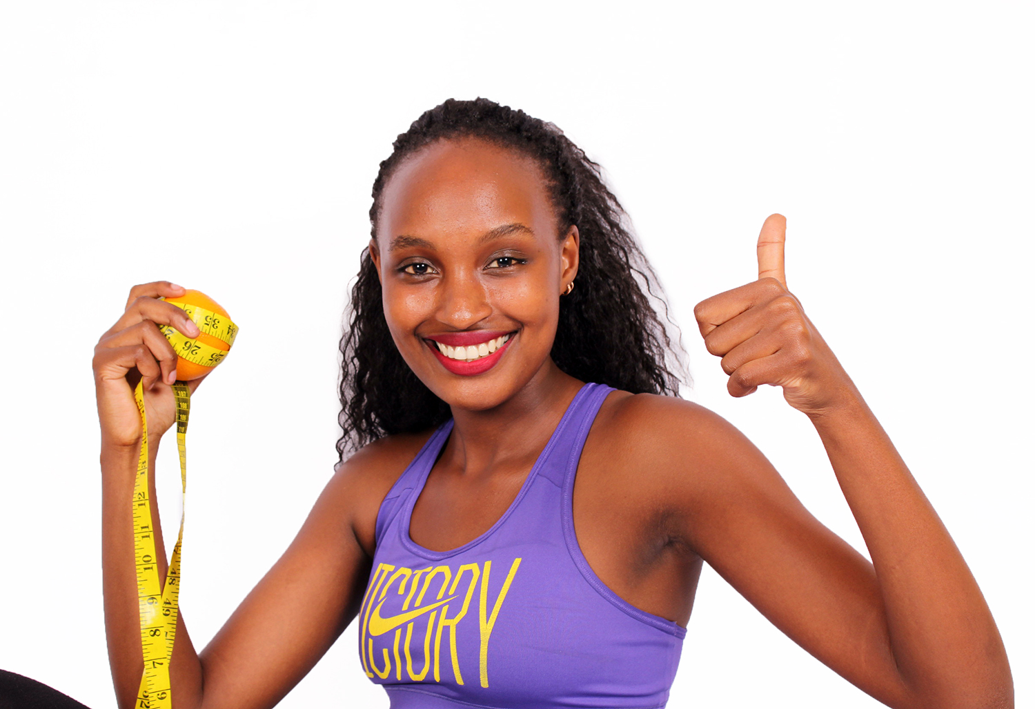 Healthy Lifestyle Concept. Woman Holding Orange Fruit Wrapped With Tape Measure