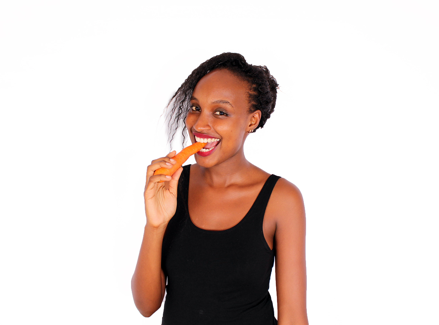 Healthy woman eating raw carrot