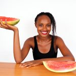 Healthy Woman Holding Juicy Sliced Watermelon