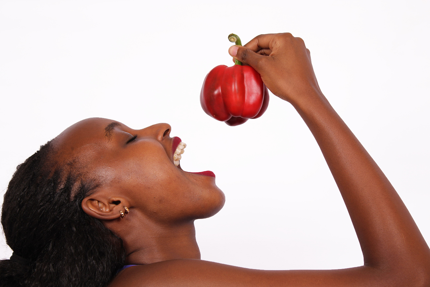 Close Up Healthy Woman Eating Capsicum Red Pepper
