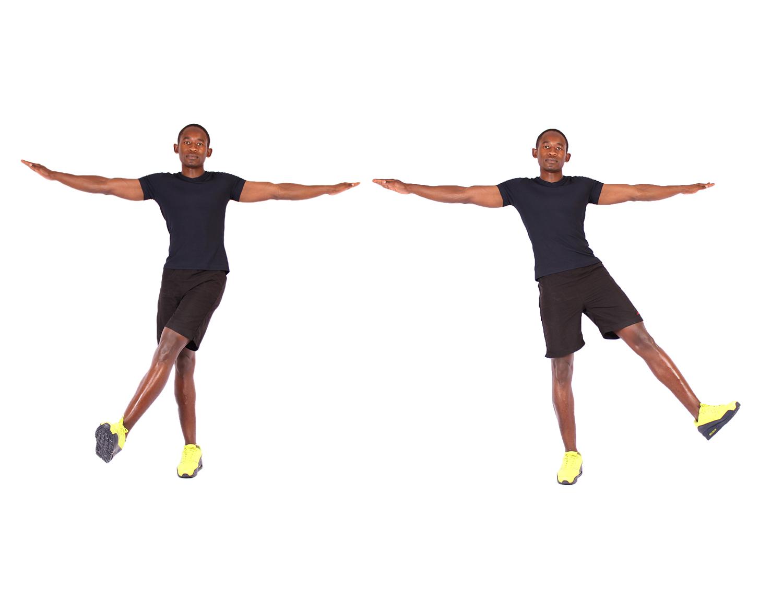 Male athlete doing side leg swings