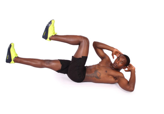 Man doing bicycle ab crunches exercise