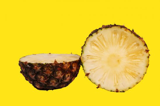 Pineapple slices on yellow background