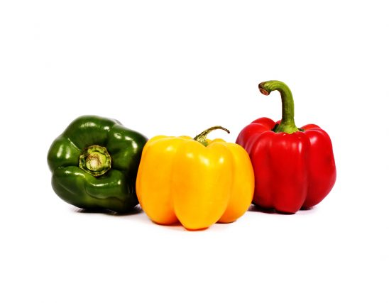 Red green and yellow pepper isolated on white background