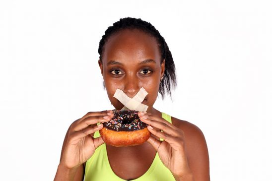 Restrictive dieting concept woman not allowed to eat doughnut