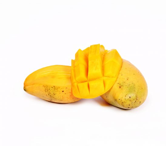 Sliced fresh mango on white background