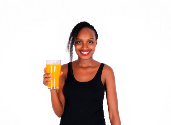 Smiling woman holding glass of fresh juice