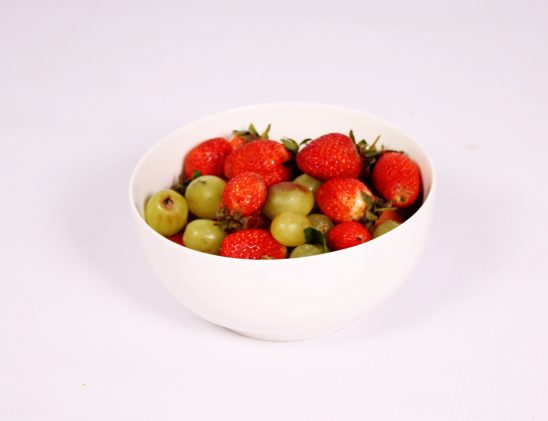 Strawberries and green grapes in a bowl