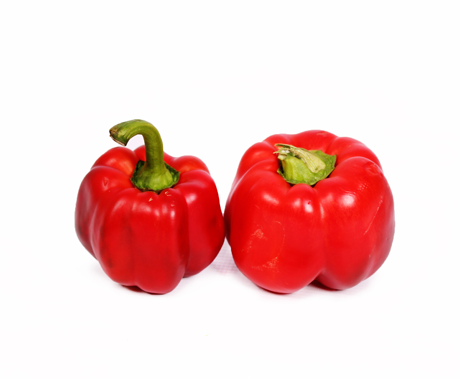 Two fresh Capsicum red peppers