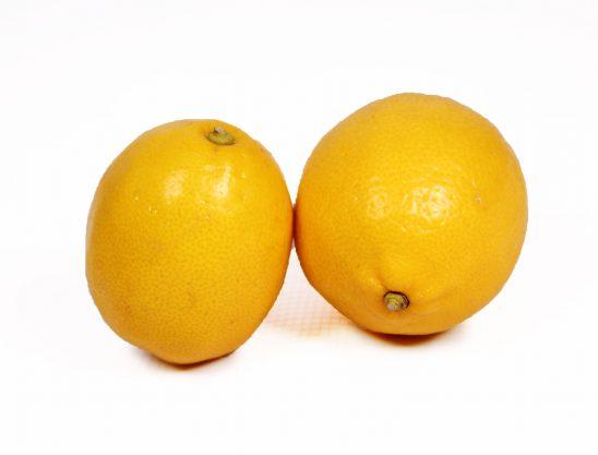 Two lemons isolated on white background