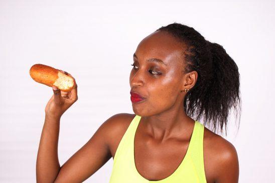 Unhealthy food woman eating a doughnut