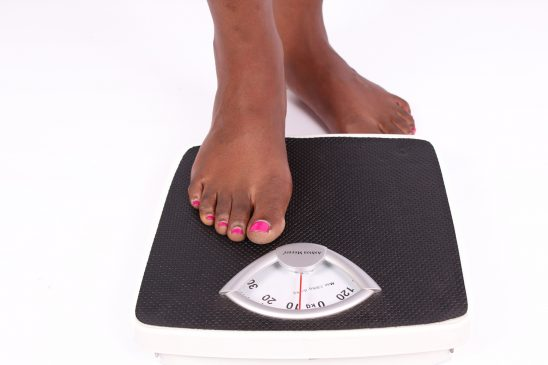 Woman ready to measure weight on weigh scale