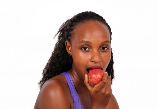 Young healthy woman eating apple fruit