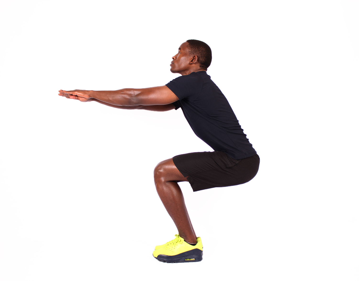 Muscular man doing air squats exercise