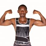 Muscular Man Wearing Weighted Vest Flexing Biceps